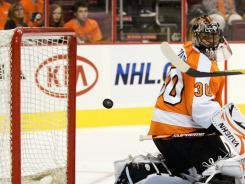 Flyers goalie Ilya Bryzgalov watches a shot by the Maple Leafs' Joe Colborne head into the net in the third period. Bryzgalov allowed three goals in his Flyers debut.