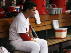 Fernando Salas sits in the dugout after being taken out of Thursday's game in the ninth inning against the Mets. Salas recorded just two outs and gave up a run on on two hits and a walk and blew his sixth save of the season.