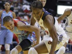Indiana's Tamika Catchings, right, and Atlanta's Armintie Price scramble for a loose ball during the first half of Game 1 of the WNBA  Eastern Conference finals on Thursday.