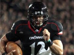 Cincinnati quarterback Zach Collaros runs for a touchdown against North Carolina State during the Bearcats' 44-14 on Thursday.