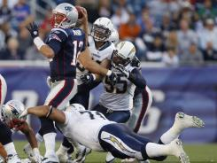 The Chargers' Antonio Garay received a $15,000 fine for this hit on Patriots quarterback Tom Brady last weekend.