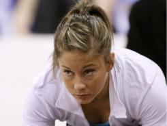 Shawn Johnson, seen here stretching at an event  in Chicago in July, won't be going to the World Championships in Japan. Instead, she'll be going to the Pan-American Games in Mexico.