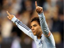 Sporting Kansas City's Omar Bravo celebrates his 56th-minute goal that gave his team a 1-0 lead. The goal was Bravo's ninth of the season.