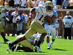 Georgia Tech quarterback Tevin Washington  scores the go-ahead touchdown in the fourth quarter against North Carolina.