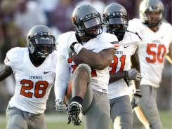 Oklahoma State linebacker James Thomas (22) celebrates after his interception in the fourth quarter secured a win against Texas A&M.