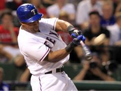 Adrian Beltre hit one of three Rangers home runs in their 5-3 win over the Mariners on Friday night. The win coupled with an Angels loss gave the Rangers another AL West crown.