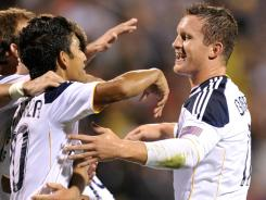 Chad Barrett celebrates with teammates after scoring the L.A. Galaxy's game winning goal in the third minute of stoppage time, beating the Columbus Crew 1-0 Saturday night..