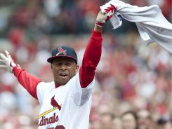 St. Louis Outfielder Adron Chambers  cheers Yadier Molina's 7th inning homer against the Chicago Cubs on Sunday.