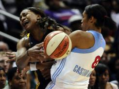 The Dream's Iziane Castro Marques, right, battling with the Fever's Tamika Catchings, scored a game-high 30 points on 13-for-22 shooting.
