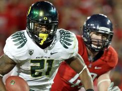 Running back LaMichael James (21) set an Oregon record with 288 yards rushing as the 13th-ranked Ducks routed Pac-12 rival Arizona 56-31 on Saturday.