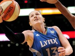 Minnesota Lynx guard Lindsay Whalen throws up a shot agains the Phoenix Mercury on Sunday. The Lynx topped the Mercury, earning a spot in the WNBA finals in the process.