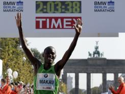 Patrick Makau celebrates after setting a world record while winning the Berlin Marathon on Sunday.