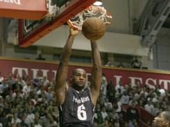 "Team Melo's LeBron James scores against Team Phillly  in the first half of  th ""Battle of I-95"" basketball game on Saturday at the University of Pennsylvania."