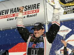 Tony Stewart celebrates in victory lane after winning the Sylvania 300 Sunday at New Hampshire Motor Speedway.