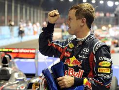 Sebastian Vettel pumps his fist after winning the Singapore Grand Prix from the pole on Sunday.