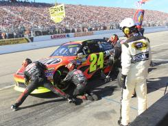 Jeff Gordon, getting his No. 24 Chevrolet filled up at Sunday's race at New Hampshire Motor Speedway, laid off the gas toward the end of the Sylvania 300 and finished fourth.