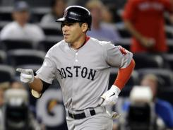 Jacoby Ellsbury trots home after his homer in the 14th inning Sunday kept the Red Sox from falling into a wild-card tie.