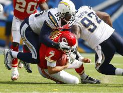 Chargers defenders Shaun Phillips and Vaughn Martin