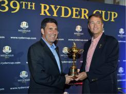 ORG XMIT: ILJP109 2012 European Ryder Cup Captain Josr Maria Olazabal, left, and U.S. captain Davis Love III  pose with the Ryder Cup trophy at a news conference Monday.
