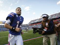 Bills quarterback Ryan Fitzpatrick runs off the field after his team beat the  Patriots 34-31 to start the season 3-0.