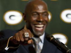 Green Bay Packers wide receiver Donald Driver wears his Super Bowl ring while answering questions from the media following the  ceremony at Lambeau Field.