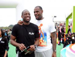 Dwyane Wade and LeBron James, here at a Nickolodeon event Saturday in Washington, D.C., will help host a game in Miami vs. other NBA players during the lockout.