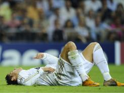 Real Madrid forward Cristiano Ronaldo gestures on the ground during the UEFA Champions league first leg match against Ajax at the Santiago Bernabeu stadium in Madrid on Tuesday.