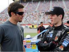 Ryan Truex, right, visits with his older brother, Martin, during the race weekend at Atlanta Motor Speedway in early September.