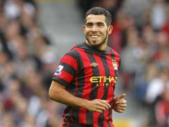 Manchester City's Carlos Tevez reacts as he runs on the pitch as a substitute against Fulham during their English Premier League soccer match at Craven Cottage, London, on Sept. 18.