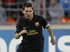 Barcelona's Lionel Messi scored a goal in each half of the defending champion's 5-0 win over BATE Borisov, as the Spanish side picked up its first Champions League win of the season.