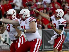 Quarterback Taylor Martinez (3) and the Nebraska Cornhuskers will play Wisconsin this Saturday night.