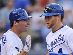 Alex Gordon, right, and Jeff Francoeur turned in solid years at the plate for the Royals, but the outfielders also led the majors in assists with 20 and 16, respectively.