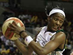 Seattle Storm's Swin Cash grabs a rebound in front of Connecticut Sun's Kelsey Griffin in the first half of a WNBA game Aug. 5 in Seattle.Cash is among the players heading to Europe for a 12-day tour.