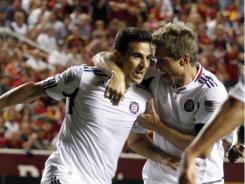 Chicago Fire midfielder Marco Pappa, left, notched a hat trick in the Fire's 3-0 victory over Real Salt Lake, only the team's second road win of the season.
