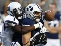 Utah State's Nevin Lawson, left, knocks a pass away from BYU's McKay Jacobson. BYU won 27-24 with a touchdown in the final minute of the game.