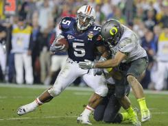 Auburn's Jake Holland takes the ball to the one to set up the winning score during the 2011 BCS National Championship.