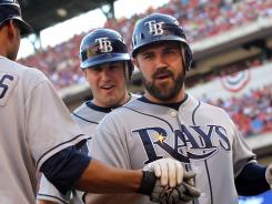 Kelly Shoppach, right, hit a three -run homer in the third inning as the Rays took game one of the American League Division Series at Rangers Ballpark in Arlington.