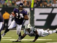 Baltimore Ravens running back Ray Rice rushed for just 43 yards on 21 attempts during the 2010 season opener against Bryan Thomas and the Jets.