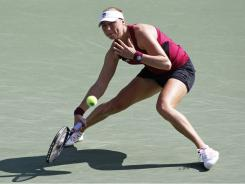 Vera Zvonareva of Russia chases down a forehand during her victory Friday against Petra Kvitova of the Czech Republic.