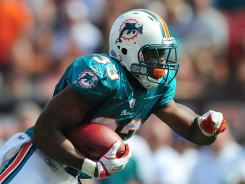 Rookie Daniel Thomas leads Miami's ground game with 41 carries and 202 rushing yards.