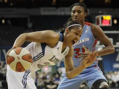 Maya Moore, left, averaged 12.5 points 5.0 rebounds and 4.5 assists in two wins over the Dream this season. Angel McCoughtry, right, averaged 17 points and 5.5 rebounds in their matchups.