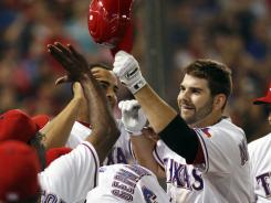 Texas Rangers first baseman Mitch Moreland, second from right, celebrates his eighth inning homer against Tampa Bay on Saturday night.