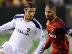 David Beckham, right, and the Los Angeles Galaxy topped Real Salt Lake 2-1 on Saturday night after falling behind a goal in the first half.