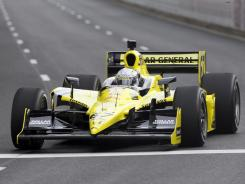 Ed Carpenter and owner Sarah Fisher Racing earned their first career IndyCar wins Sunday at Kentucky Speedway.