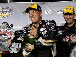 Ron Hornaday Jr., center, and his team celebrate winning the NASCAR's Truck Series Kentucky 225 on Saturday.