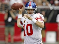 Eli Manning threw two  touchdown passes in the final 3:37 to help the Giants win their third consecutive game.