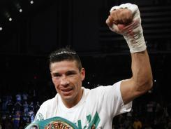 Sergio Martinez celebrates after knocking out Darren Barker to maintain his middleweight title on Saturday in Atlantic City.