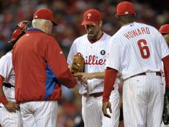 Cliff Lee, center, and the  Phillies were supposed to be invincible this postseason. Too bad no one told the Cardinals.