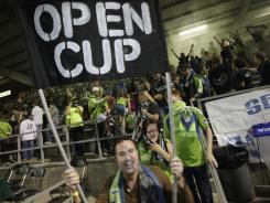 Seattle fans celebrate following the club's 1-0 win over FC Dallas in the U.S. Open Cup semifinal on Aug. 30. The Sounders host the Chicago Fire at CenturyLink Field in the final Tuesday, looking to win its third consecutive U.S. Open Cup.