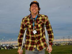 "Travis Pastrana, shown before a trucks race at Chicagoland Speedway, said he'll be off crutches ""hopefully"" in a month."